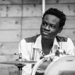 Black and white image of musician Eze Wendtoin